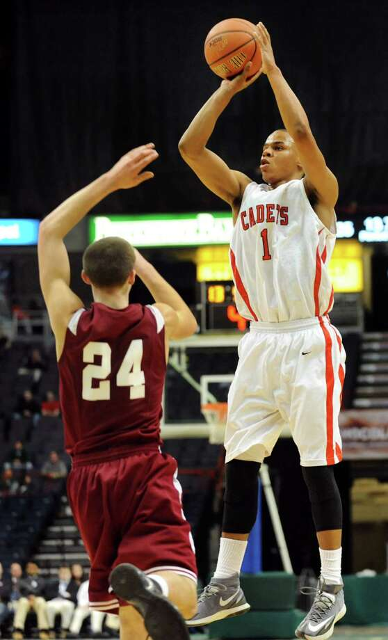 Albany Academy's Ray Jerome, right, shoots for three points as Scotia's Joe Cremo defends during their Federation Class A basketball semifinal against Scotia on Friday, March 21, 2014, at Times Union Center in Albany, N.Y. (Cindy Schultz / Times Union) Photo: Cindy Schultz / 00026202A