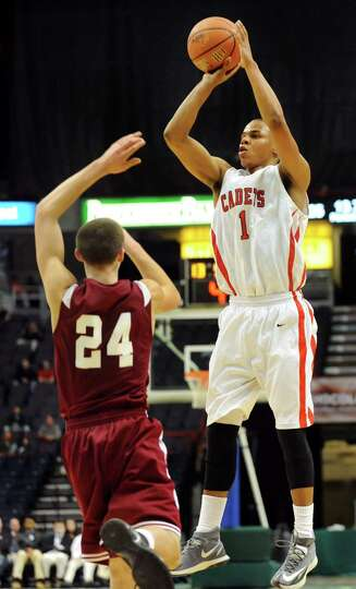 Albany Academy's Ray Jerome, right, shoots for three points as Scotia's Joe Cremo defends during the