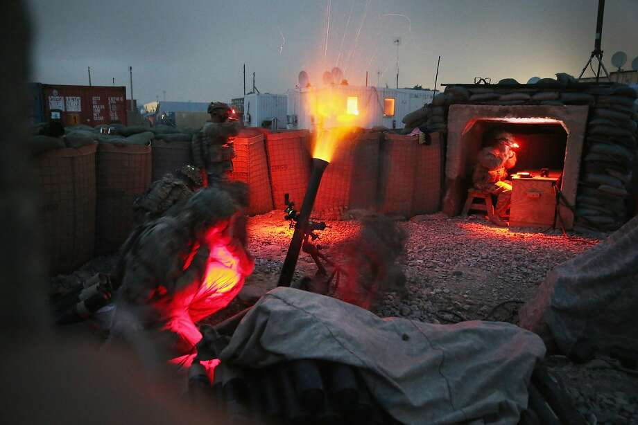Fire in the hole:Soldiers of the Army's 3rd Brigade Combat Team, 10th   Mountain Division, fire a mortar round during a training exercise at Forward Operating Base Lightning near Gardez, Afghanistan. Their mission is to advise and assist the   Afghan National Army at nearby FOB Thunder. Photo: Scott Olson, Getty Images