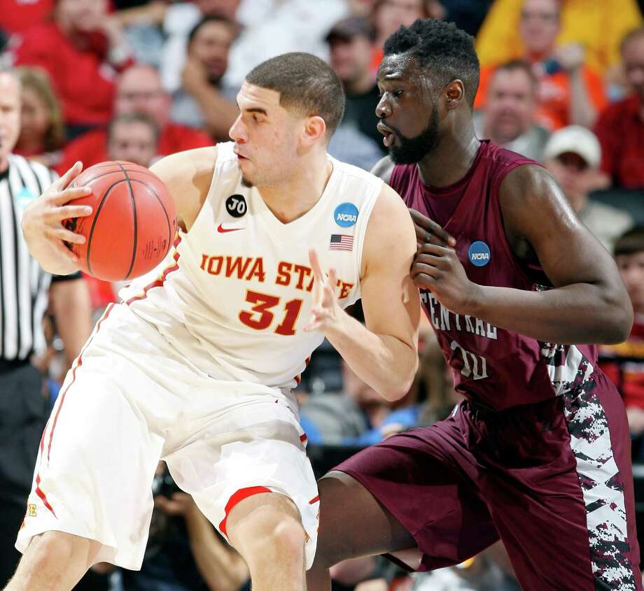 Iowa State's Georges Niang (31) looks for room around North Carolina Central's Karamo Jawara (10) during first half action of their second round 2014 NCAA Division I Men's Basketball Championship game held Friday March 21, 2014 at the AT&T Center. Photo: San Antonio Express-News / © 2014 San Antonio Express-News