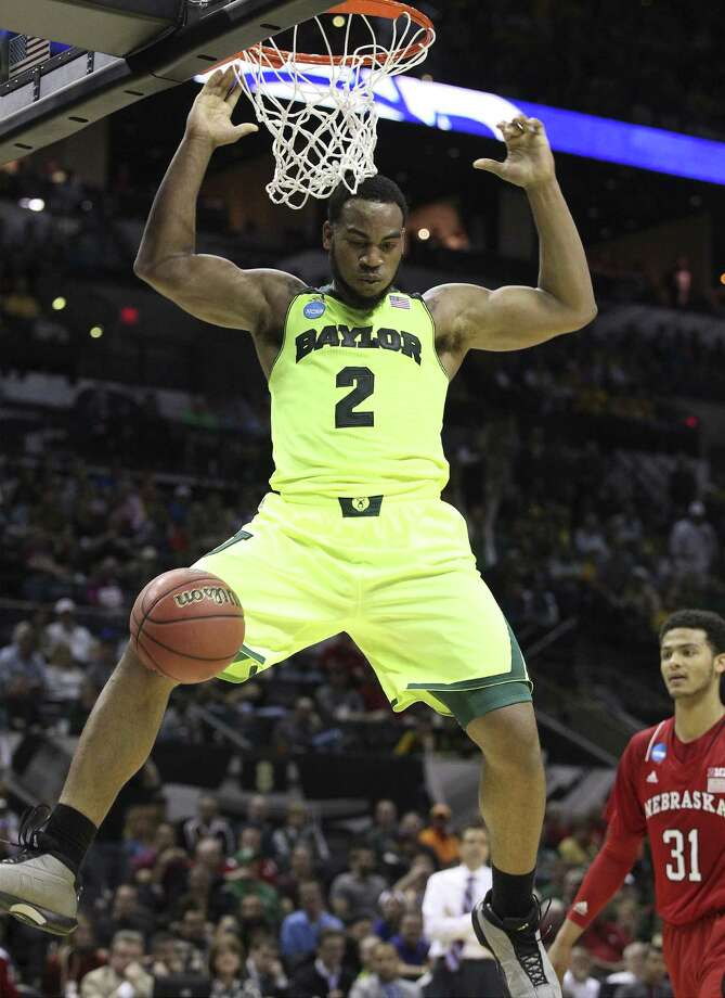 Baylor's Rico Gathers dunks for two of his 11 points as Nebraska's Shavon Shields watches in the first half of Friday's second-round game at the AT&T Center. Gathers also had six rebounds. Photo: Kin Man Hui / San Antonio Express-News / ©2013 San Antonio Express-News