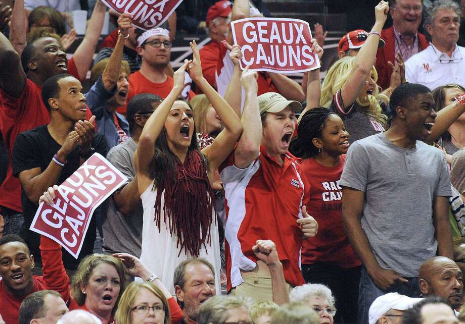 Louisiana-Lafayette Ragin' Cajuns fans encourage their team during second-round NCAA tournament action against Creighton in the AT&T Center on Friday, March 21, 2014. Photo: San Antonio Express-News / San Antonio Express-News