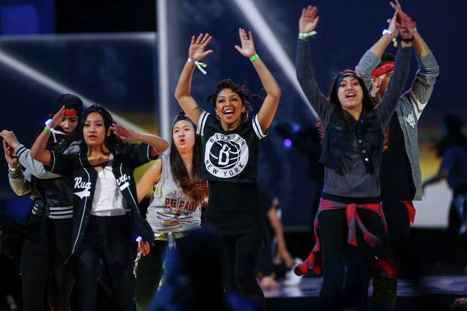 Members of The Connection dance group perform during We Day at KeyArena in Seattle. Thousands of young people came to the event. Spots were earned at We Day by students engaged in their communities. Photographed on Friday, March 21, 2014. Photo: JOSHUA TRUJILLO, SEATTLEPI.COM / SEATTLEPI.COM