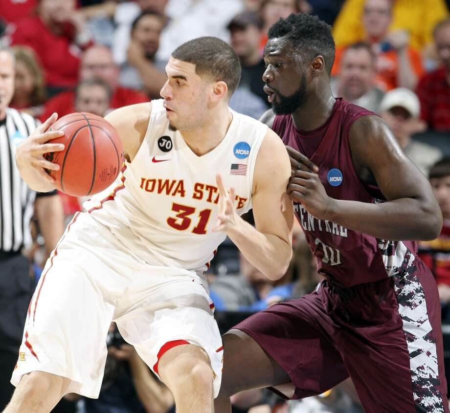 Iowa State's Georges Niang (31) looks for room around North Carolina Central's Karamo Jawara (10) during first half action of their second round 2014 NCAA Division I Men's Basketball Championship game held Friday, March 21, 2014 at the AT&T Center. Photo: Edward A. Ornelas, San Antonio Express-News