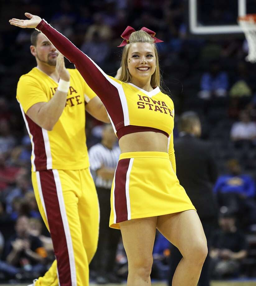 Iowa State cheerleaders enjoy the evening as North Carolina Central plays Iowa State in the second round of the 2014 NCAA Division I Men's Basketball Championship at the AT&T Center on Friday, March 21, 2014. Photo: Tom Reel, San Antonio Express-News