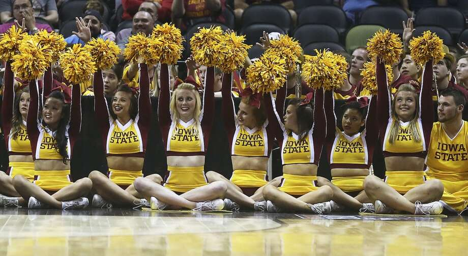 Cyclone cheerleaders check the clock near the end of their victory as North Carolina Central plays Iowa State in the second round of the 2014 NCAA Division I Men's Basketball Championship at the AT&T Center on Friday, March 21, 2014. Photo: Tom Reel, San Antonio Express-News
