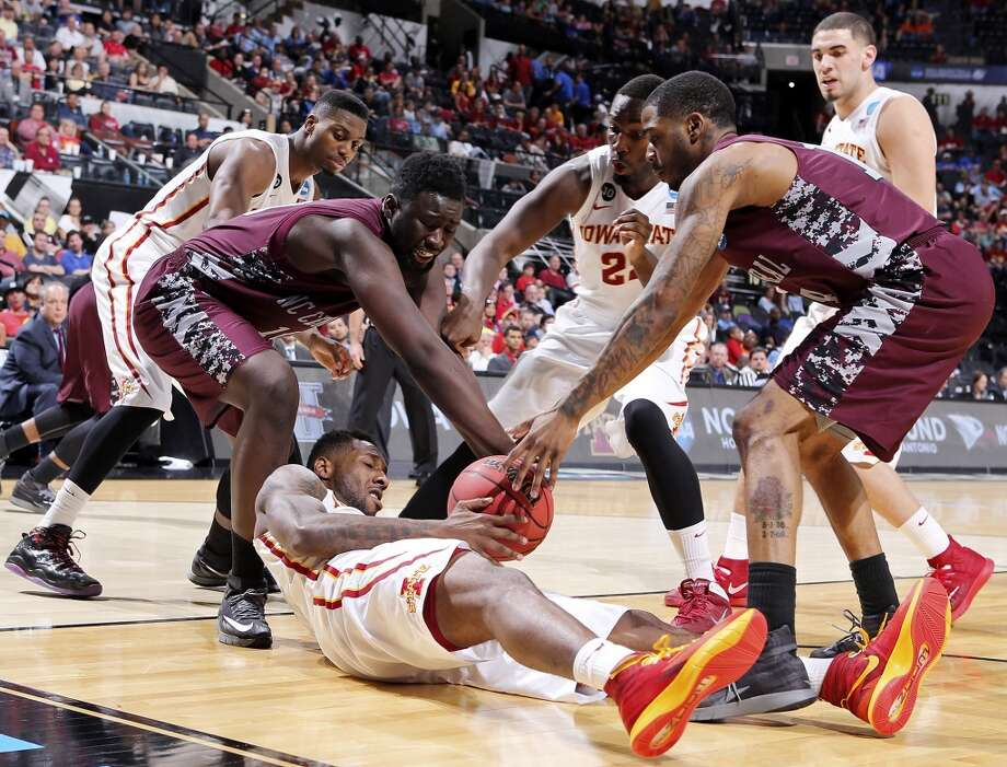 Iowa State's DeAndre Kane (50) grabs for a loose ball between North Carolina Central's Karamo Jawara (10), left, and North Carolina Central's Jeremy Ingram (14)during second half action of their second round 2014 NCAA Division I Men's Basketball Championship game held Friday, March 21, 2014 at the AT&T Center. Iowa State won 93-75. Photo: Edward A. Ornelas, San Antonio Express-News