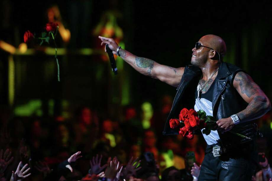 Artist Flo Rida tosses roses to fans during We Day at KeyArena in Seattle. Thousands of young people came to the event. Spots were earned at We Day by students engaged in their communities. Photographed on Friday, March 21, 2014. Photo: JOSHUA TRUJILLO, SEATTLEPI.COM / SEATTLEPI.COM