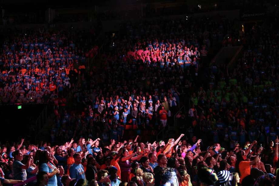 People gather in KeyArena during We Day in Seattle. Thousands of young people came to the event. Spots were earned at We Day by students engaged in their communities. Photographed on Friday, March 21, 2014. Photo: JOSHUA TRUJILLO, SEATTLEPI.COM / SEATTLEPI.COM