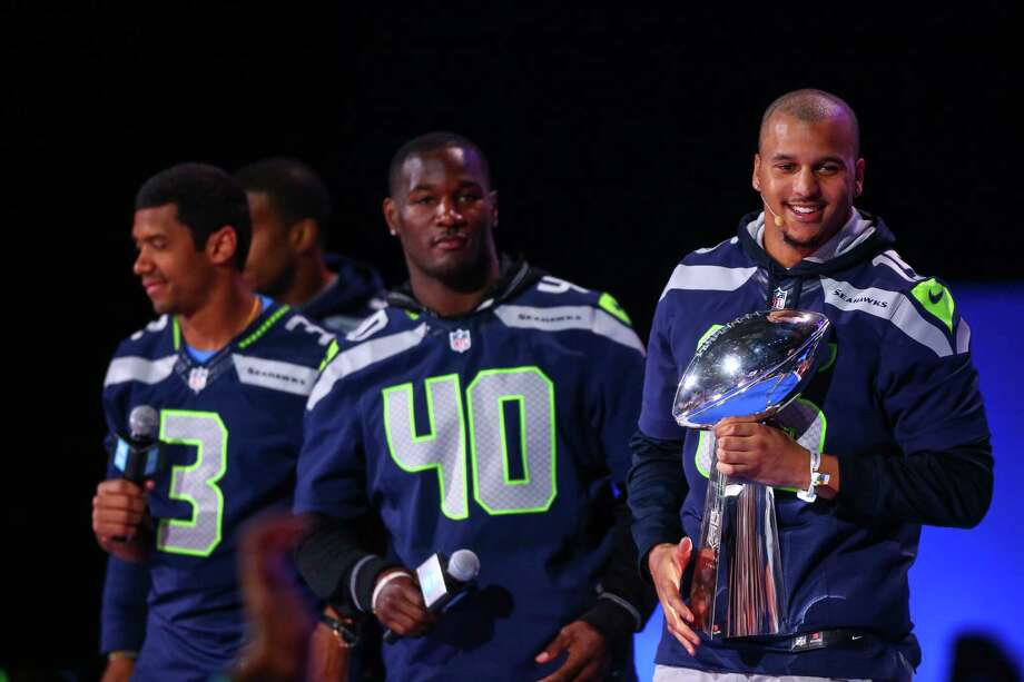 Seattle Seahawks player Jermaine Kearse  holds the Vince Lombardi Trophy during We Day at KeyArena in Seattle as Russell Wilson and Derrick Coleman also take the stage. Thousands of young people came to the event. Spots were earned at We Day by students engaged in their communities. Photographed on Friday, March 21, 2014. Photo: JOSHUA TRUJILLO, SEATTLEPI.COM / SEATTLEPI.COM