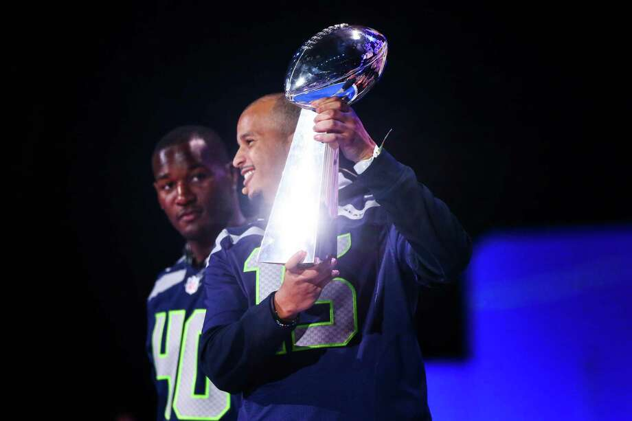 Seattle Seahawks player Jermaine Kearse  holds the Vince Lombardi Trophy during We Day at KeyArena in Seattle. Thousands of young people came to the event. Spots were earned at We Day by students engaged in their communities. Photographed on Friday, March 21, 2014. Photo: JOSHUA TRUJILLO, SEATTLEPI.COM / SEATTLEPI.COM