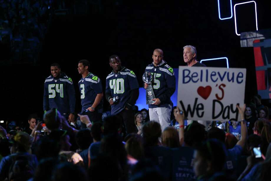 Members of the Seattle Seahawks take the stage during We Day at KeyArena in Seattle. Thousands of young people came to the event. Spots were earned at We Day by students engaged in their communities. Photographed on Friday, March 21, 2014. Photo: JOSHUA TRUJILLO, SEATTLEPI.COM / SEATTLEPI.COM