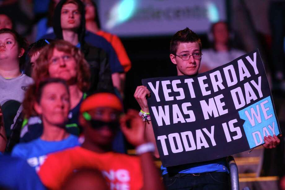 A participant holds a sign during We Day at KeyArena in Seattle. Thousands of young people came to the event. Spots were earned at We Day by students engaged in their communities. Photographed on Friday, March 21, 2014. Photo: JOSHUA TRUJILLO, SEATTLEPI.COM / SEATTLEPI.COM