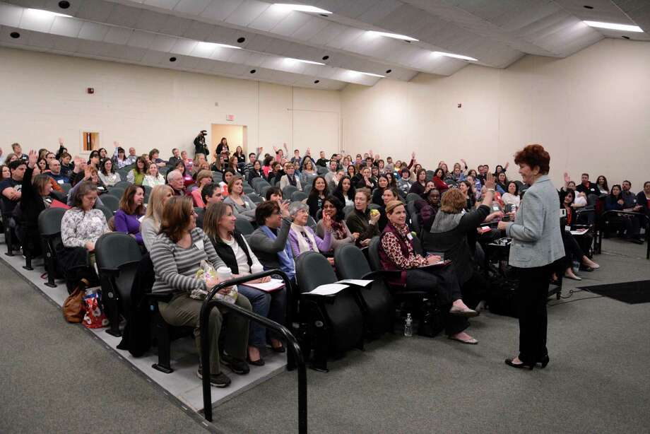 Keynote speaker Dr. Jane Nelsen, parent educator and prolific author, asks questions of the audience during her Parent Empowerment University seminar that was held at the Middle School in Newtown on Saturday, March 22, 2014. Photo: Lisa Weir / The News-Times Freelance