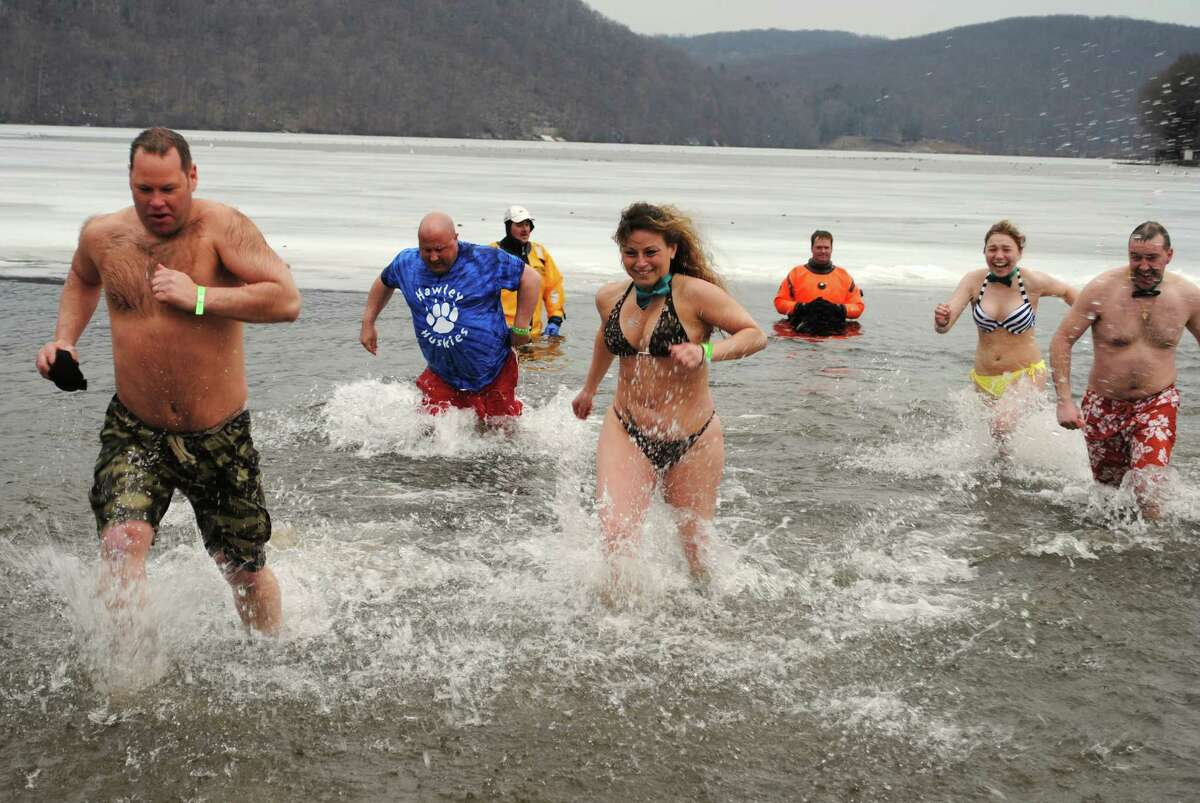 Hundreds braved cold and rain Saturday, March 22, 2014 for the 5th Annual Polar Plunge, a fundraiser for the Special Olympics at Candlewood Lake, Danbury, Were you SEEN?