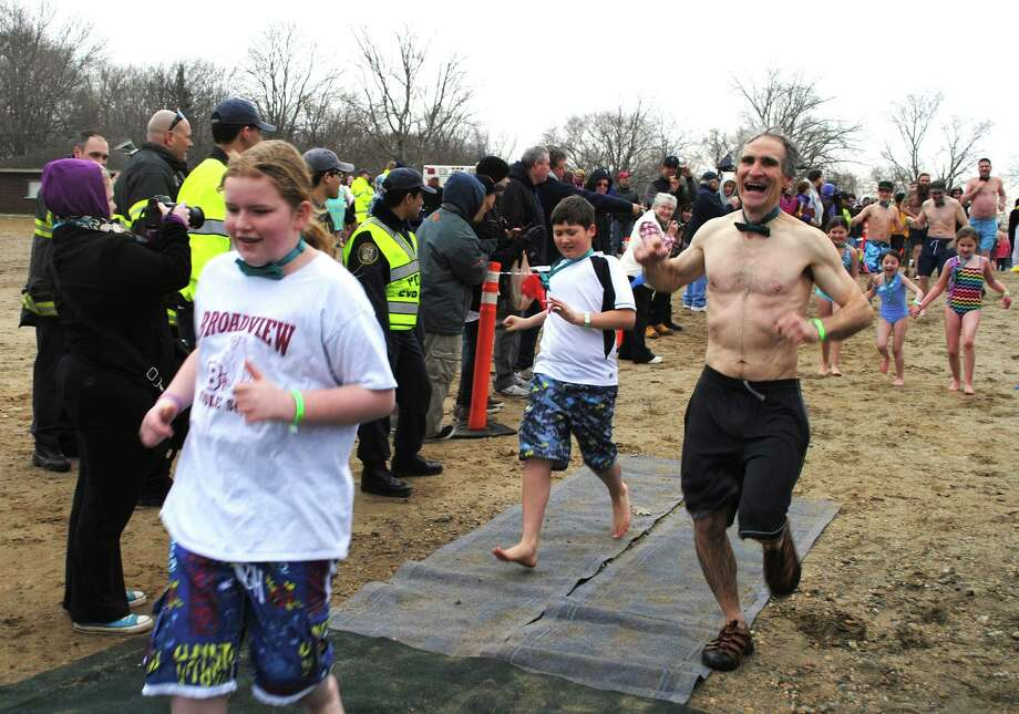 Hundreds braved cold and rain Saturday, March 22, 2014 for the 5th Annual Polar Plunge, a fundraiser for the Special Olympics at Candlewood Lake, Danbury, Were you SEEN? Photo: Wendy Mitchell