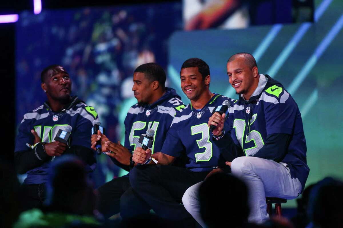 Seattle Seahawks players, from left, Derrick Coleman, Bobby Wagner, Russell Wilson, and Jermaine Kearse speak during We Day at KeyArena in Seattle. Thousands of young people came to the event. Spots were earned at We Day by students engaged in their communities. Photographed on Friday, March 21, 2014.