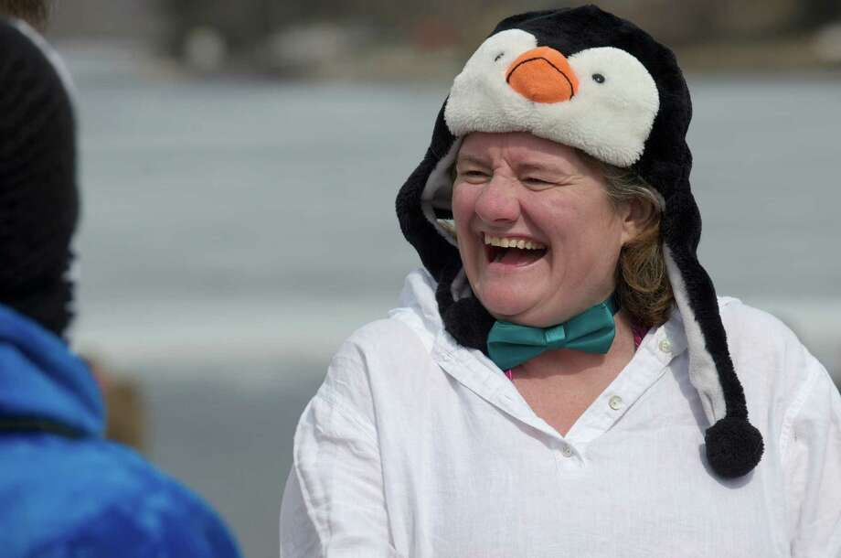 Bridget Harding, of New Milford, wears her penguin hat as she waits to jump into Candlewood Lake on Saturday, March 22, 2014, as part of the Penguin Plunge, to raise money and awareness for the Special Olympics. The plunge took place at Candlewood Lake Park, Danbury, Conn. Harding helped raise money for the Danbury Special Olympics and did the event with her daughter. Photo: H John Voorhees III / The News-Times Freelance