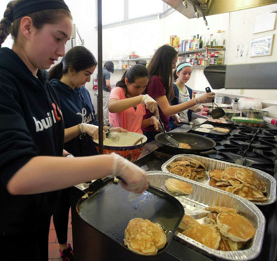 Westhill buildOn students, from left,Julia Schaffer, Yamila Marrero, Gaby Nunez, Nancy Juarez, and Kelly Finn prepare breakfast at Inspirica for residents of the shelter on Saturday, March 22, 2014. The students competed against buildOn students from area schools to make meals using ingredients they collected from food drives for the Top Chef Cooking Competition. Photo: Lindsay Perry / Stamford Advocate