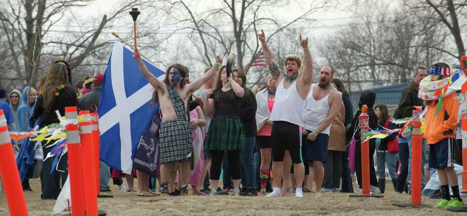 Participants in the Danbury Penguin Plunge jumped into Candlewood Lake on Saturday, March 22, 2014, to raise money and awareness for the Special Olympics, at Candlewood Lake Park, Danbury, Conn. Photo: H John Voorhees III / The News-Times Freelance