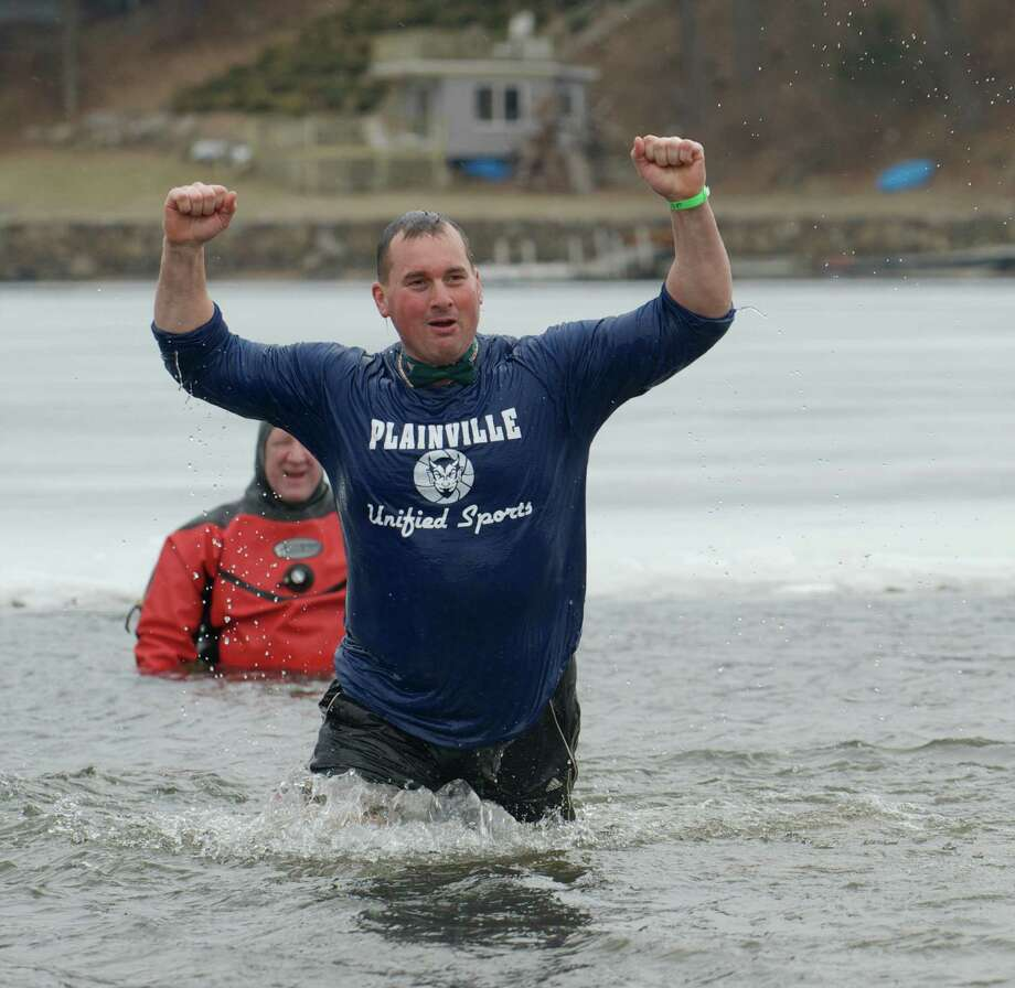Steve LePage, of Plainville, stands in Candlewood Lake on Saturday, March 22, 2014, as part of the Penguin Plunge, to raise money and awareness for the Special Olympics. The plunge took place at Candlewood Lake Park, Danbury, Conn. Photo: H John Voorhees III / The News-Times Freelance