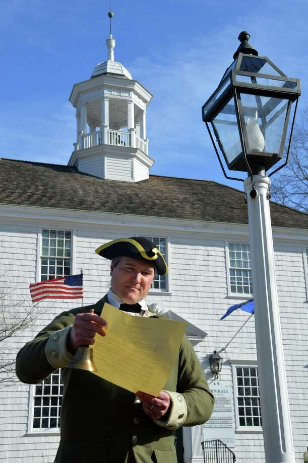 "The ""Town Crier,"" as portrayed by Walt Matis, of the Fairfield Museum and History Center, reads a proclamation of a townwide food-collection drive to mark the town's 375th anniversary. Photo: Jarret Liotta / Fairfield Citizen"
