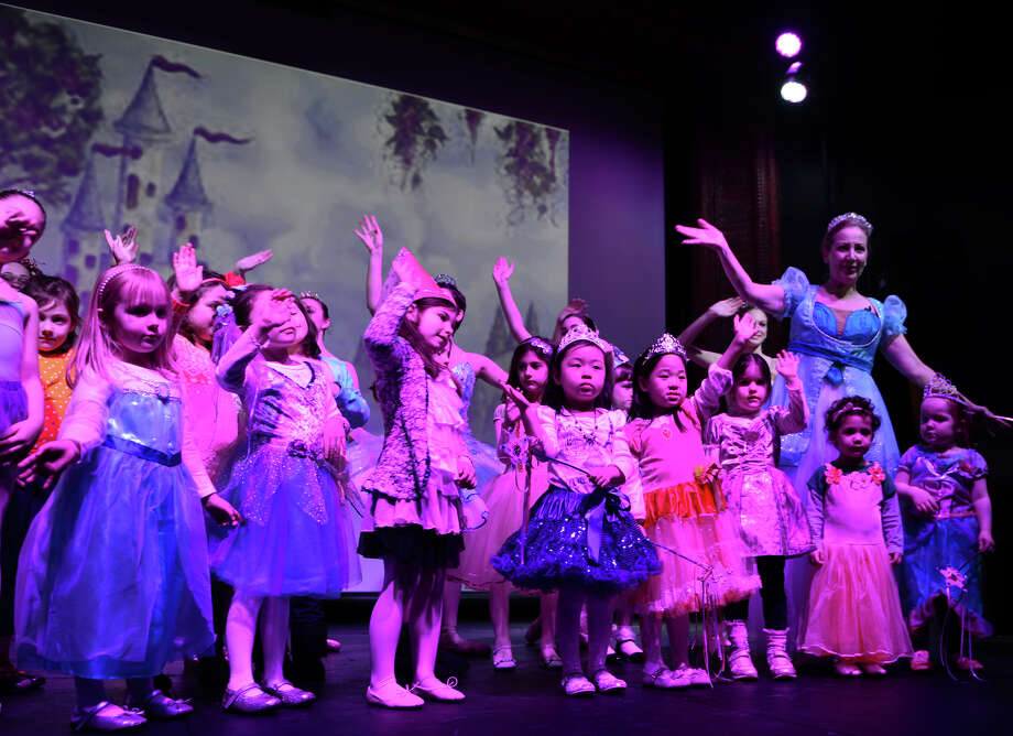 "Ballerina Princess Linda Giancaspro, teaches girls how to wave as a princess as they take part in New England Ballet Company's ""Ballerina Princess Party"" held at the Bijou Theater in downtown Bridgeport, Conn. on Saturday March 22, 2014. Photo: Christian Abraham / Connecticut Post"