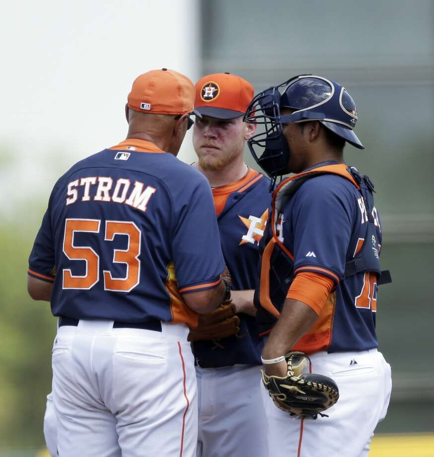 March 22: Cardinals 5, Astros 2 Astros pitching coach Brent Strom talks with pitcher Brett Oberholtzer as catcher Carlos Perez listens during the first inning. Photo: Carlos Osorio, Associated Press