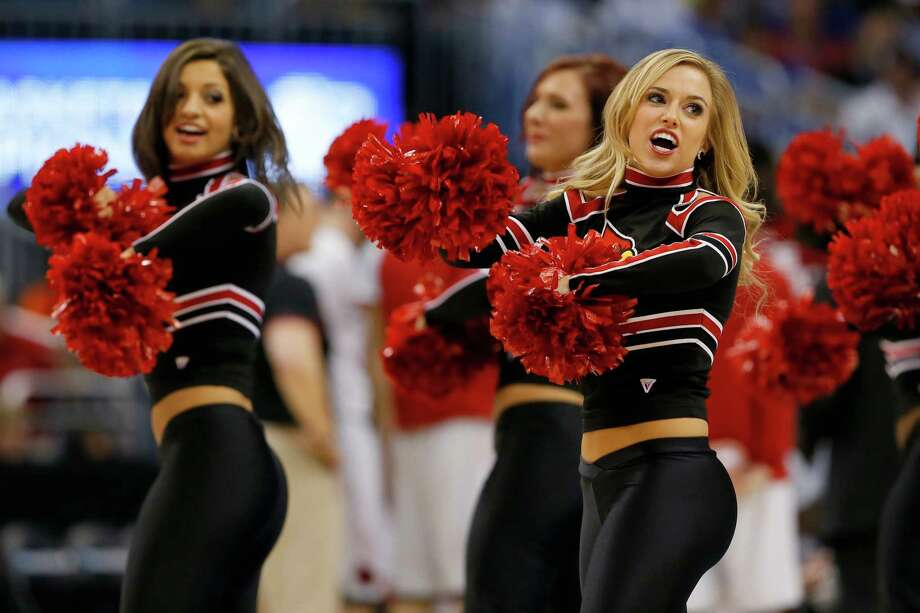 ORLANDO, FL - MARCH 22:  The Louisville Cardinals cheerleaders perform while taking on the Saint Louis Billikens during the third round of the 2014 NCAA Men's Basketball Tournament at Amway Center on March 22, 2014 in Orlando, Florida. Photo: Kevin C. Cox, Getty Images / 2014 Getty Images