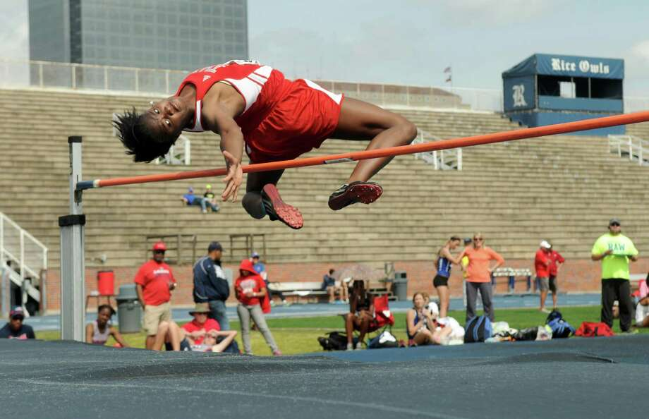 Fort Bend Travis sophomore Raina O'Neal clears the bar uring the high school high jump competition during the 63rd Annual TSU Relays at Rice University on Friday. Photo: Jerry Baker, For The Chronicle