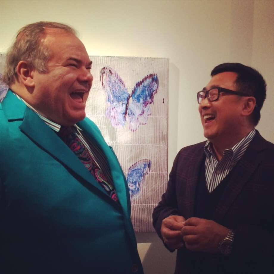 Hunt Slonem with Julian Chang at the Serge Sorokko Gallery March 20. Slonem's latest work features bunnies, but butterflies (seen in background) have also been a theme. Photo: All Photos: Carolyne Zinko, The Chronicle