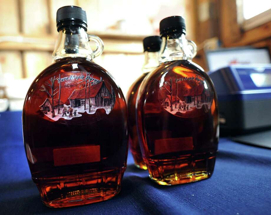 Bottled maple syrup for sale in the sugar shack on Saturday, March 22, 2014, at Sugar Oak Farms in Malta, N.Y. The Maple Open House Weekends, put on by the Upper Hudson Maple Producers Association, continues Sunday and next weekend from 10 a.m. to 4 p.m. each day, allowing the public to take a free tour of area sugarhouses. (Cindy Schultz / Times Union) Photo: Cindy Schultz / 00026217A