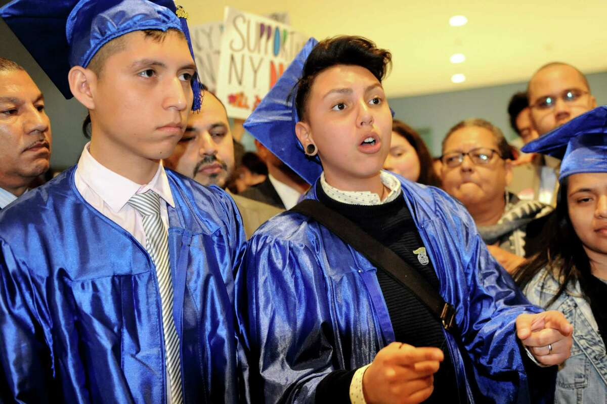 Antonio Alarcon, 19, left, and Mateo Tabares, 18, both of Queens speak at a rally to support the New York Dream Act during Somos la Futura on Saturday, March 22, 2014, at the Empire State Plaza in Albany, N.Y. (Cindy Schultz / Times Union)