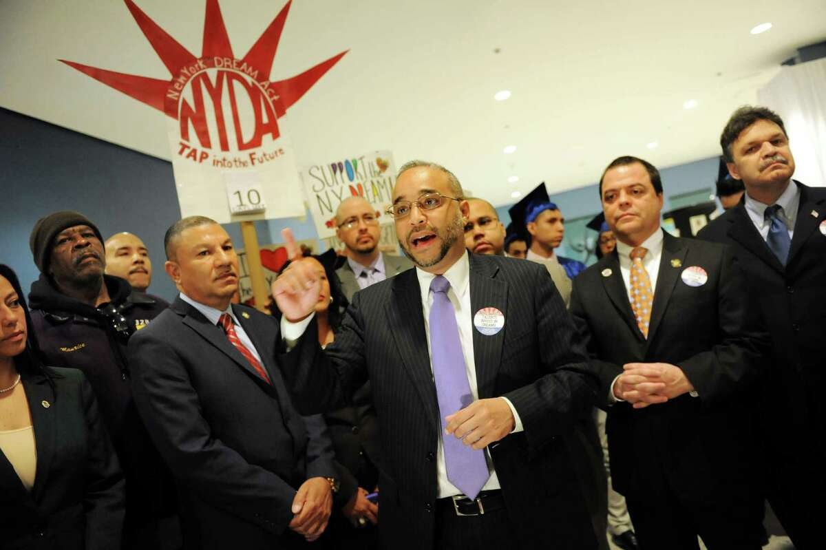Sen. Jose Peralta, center, who sponsored the New York Dream Act in the Senate, calls on Gov. Cuomo to support the legislation during Somos la Futura on Saturday, March 22, 2014, at the Empire State Plaza in Albany, N.Y. (Cindy Schultz / Times Union)