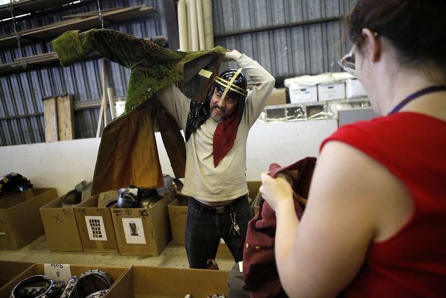 Samuel Coniglio of Oakland tries out a look during the San Francisco Opera's sale of used costumes and accessories. Items ranged from $1 masks to high-end designers' extravagant interpretations of 18th century gowns. Photo: Michael Short, The Chronicle