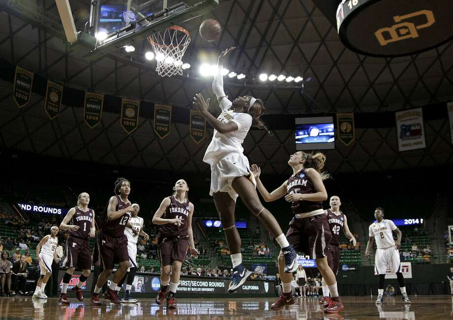 Cal's Reshanda Gray, who scored 10 points, flies to the basket in the first half, making spectators of the others on the court. Photo: Tony Gutierrez, Associated Press