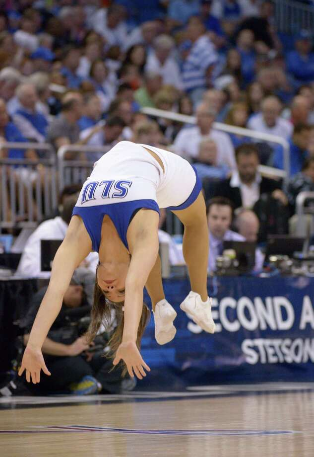 A Saint Louis cheerleader performs during the first half in a third-round game in the NCAA college basketball tournament against Louisville, Saturday, March 22, 2014, in Orlando, Fla. (AP Photo/Phelan M. Ebenhack) Photo: Phelan M. Ebenhack, Associated Press / FR121174 AP