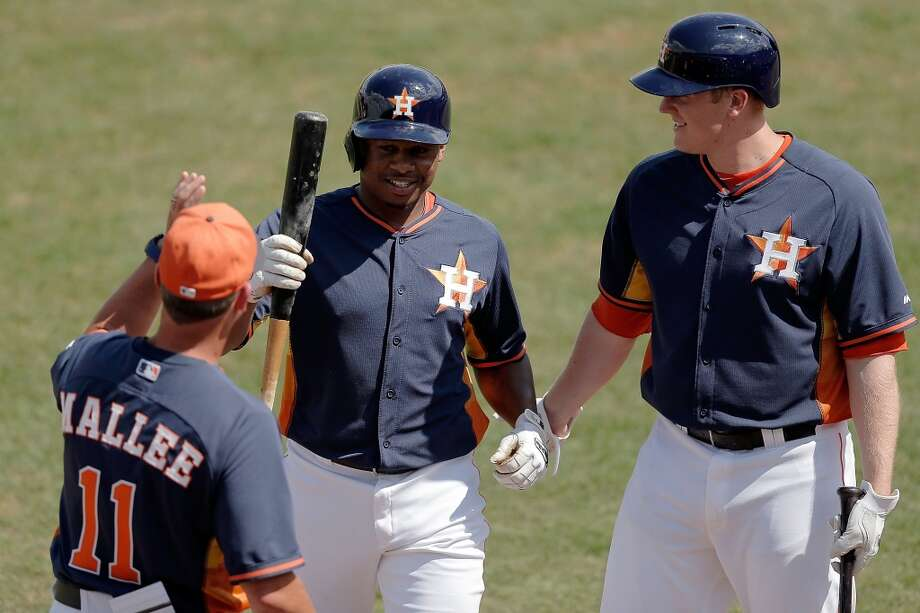 Adron Chambers is congratulated by teammates in the fifth inning. Photo: Stacy Revere, Getty Images