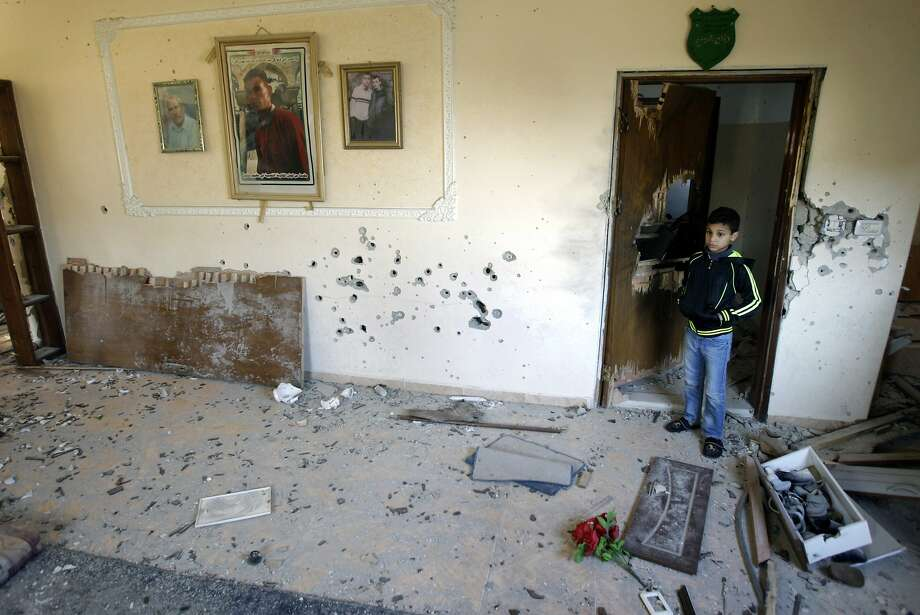 A Palestinian child stands inside the home of Hamza Abu El-Hijja, a 22-year-old militant killed by Israeli troops in the West Bank refugee camp of Jenin. Photo: Mohammed Ballas, Associated Press