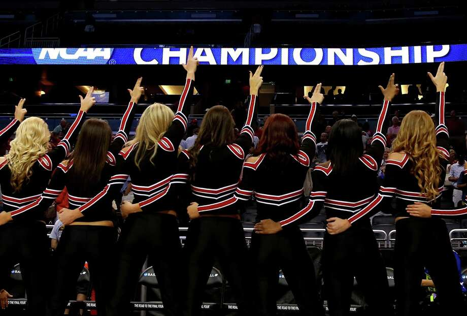 ORLANDO, FL - MARCH 22:  The Louisville Cardinals cheerleaders point after the Cardinals 66-51 victory against the Saint Louis Billikens during the third round of the 2014 NCAA Men's Basketball Tournament at Amway Center on March 22, 2014 in Orlando, Florida. Photo: Mike Ehrmann, Getty Images / 2014 Getty Images