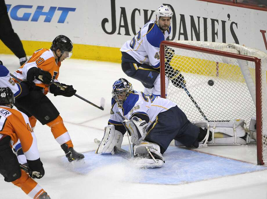 Philadelphia's Brayden Schenn scores against St. Louis goalie Ryan Miller on the way to the Flyers' fifth straight victory. Photo: Eric Hartline, Reuters