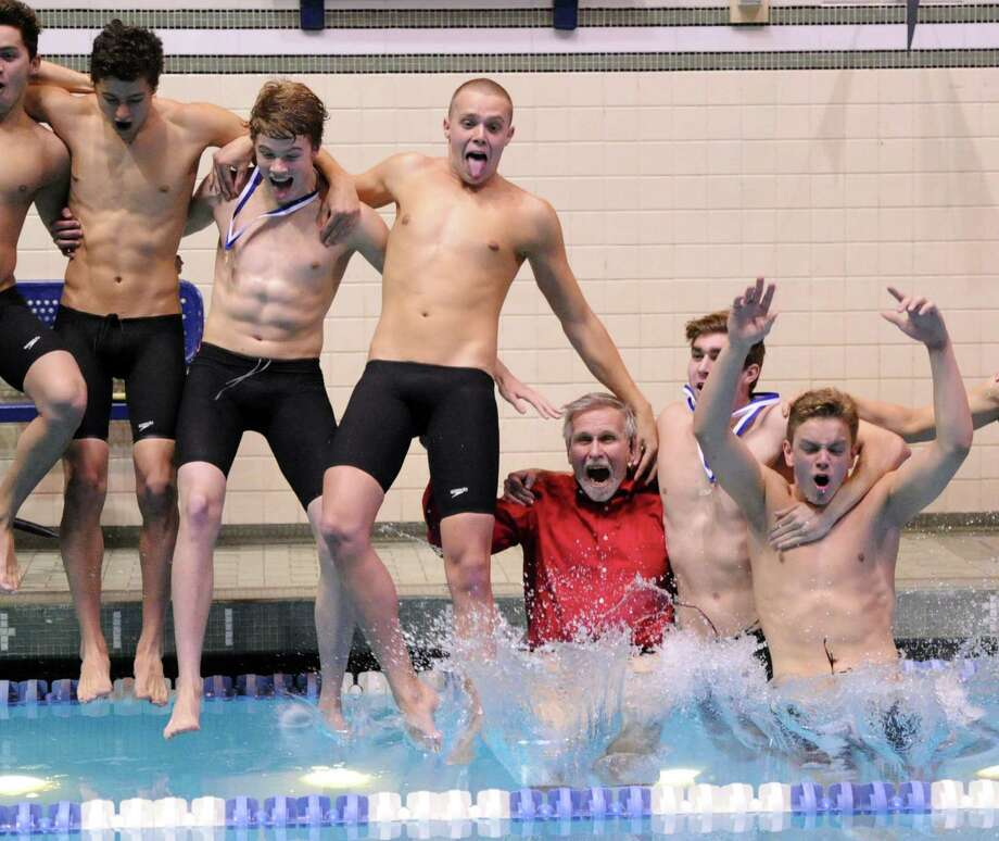 Greenwich High School swim coach, Terry Lowe, third from right, and his Greenwich High School swim team, jump into the pool after winning the State Open Boys High School Swimming Championships at Yale University, New Haven, Conn., Saturday, March 22, 2014. Photo: Bob Luckey / Greenwich Time