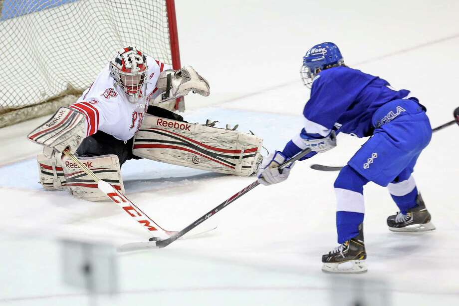 Fairfield Prep's goalie #35 Christopher Gutierrez makes a save from Darien High School's #3 Thomas Watters during first period action at Saturday afternoon's CIAC State Finals. Fairfield Prep would win 2-1 in sudden death overtime. Photo: Mike Ross / Mike Ross Connecticut Post freelance -www.mikerossphoto.com