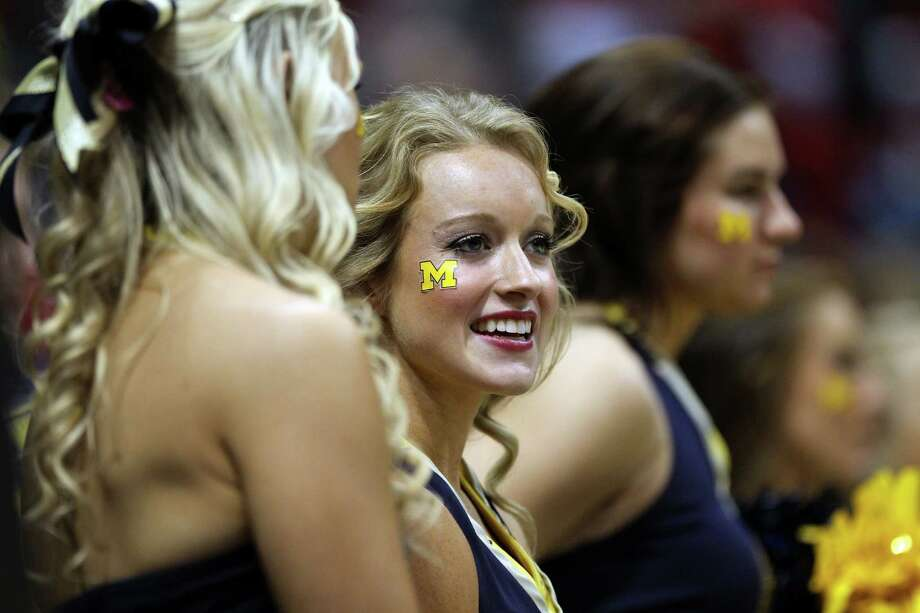 MILWAUKEE, WI - MARCH 22:  Michigan Wolverines cheerleaders perform against the Texas Longhorns during the third round of the 2014 NCAA Men's Basketball Tournament at BMO Harris Bradley Center on March 22, 2014 in Milwaukee, Wisconsin. Photo: Mike McGinnis, Getty Images / 2014 Getty Images