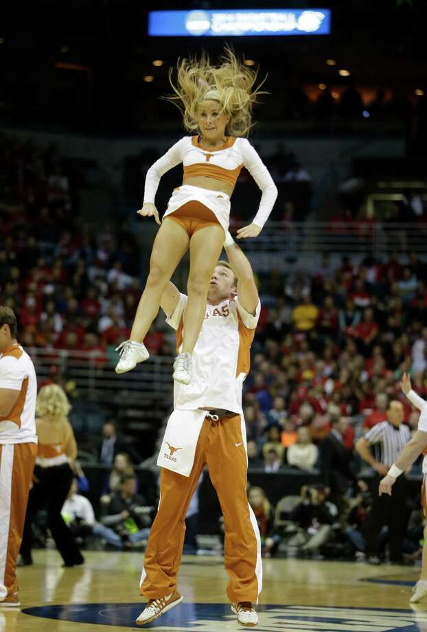 Texas cheerleaders perform during the first half of a third-round game between the Michigan and the Texas of the NCAA college basketball tournament Saturday, March 22, 2014, in Milwaukee. (AP Photo/Morry Gash) Photo: Morry Gash, Associated Press / AP