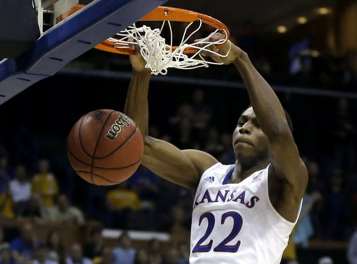 Kansas' Andrew Wiggins dunks the ball during the second half of a second-round game against Eastern Kentucky in the NCAA college basketball tournament Friday, March 21, 2014, in St. Louis. Kansas won 80-69. (AP Photo/Jeff Roberson)