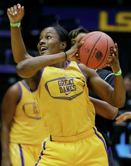 Albany forward Shereesha Richards looks for a shot during practice at the NCAA women's college baske