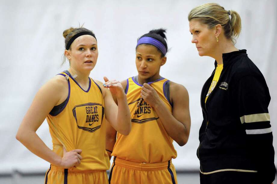 UAlbany's Sarah Royals, left, and Margarita Rosario, center, talk with coach  Katie Abrahamson-Henderson as they prepare for their NCAA game against West Virginia on Thursday, March 20, 2014, at SEFCU Arena in Albany, N.Y. (Cindy Schultz / Times Union) Photo: Cindy Schultz / 00026214A