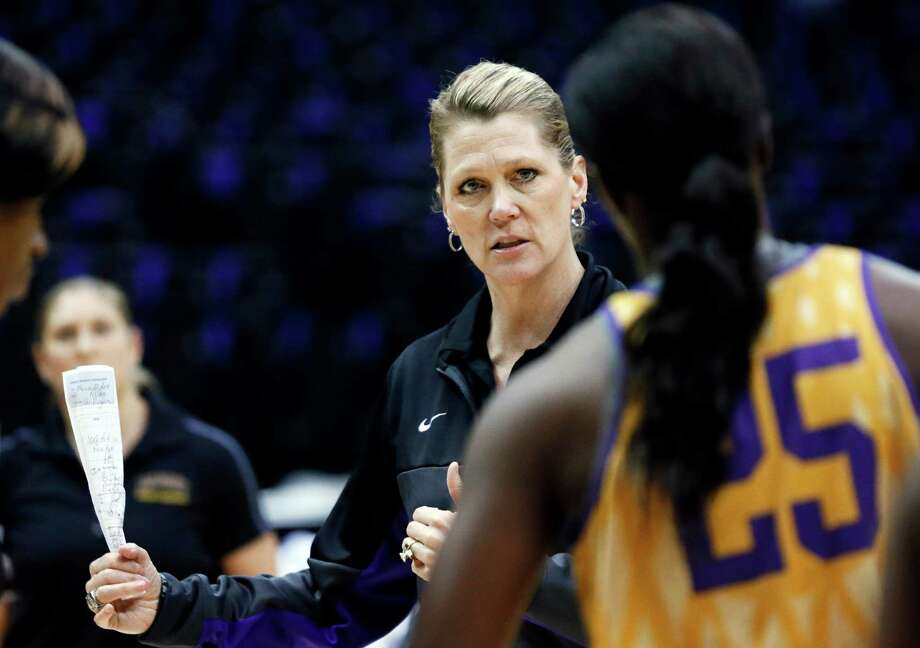 Albany coach Katie Abrahamson-Henderson discusses a play with forward Shereesha Richards (25) during practice at the NCAA women's college basketball tournament in Baton Rouge, La., Saturday, March 22, 2014. Albany faces West Virginia in a first-round game Sunday. (AP Photo/Rogelio V. Solis) ORG XMIT: LARS129 Photo: Rogelio V. Solis / AP