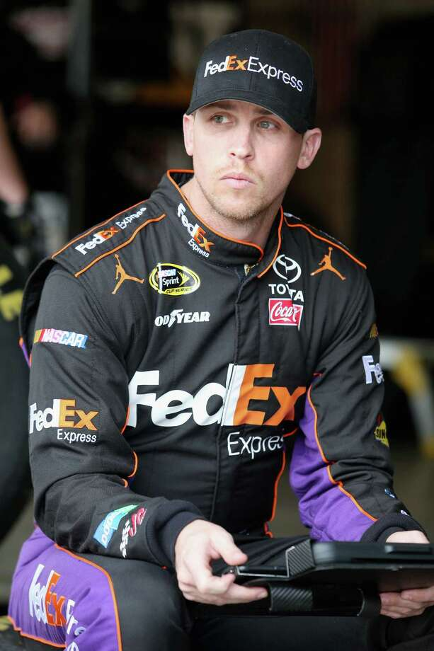 FONTANA, CA - MARCH 22:  Denny Hamlin, driver of the #11 FedEx Express Toyota, looks on during practice for the NASCAR Sprint Cup Series Auto Club 400 at Auto Club Speedway on March 22, 2014 in Fontana, California.  (Photo by Todd Warshaw/Getty Images) ORG XMIT: 463749081 Photo: Todd Warshaw / 2014 Getty Images